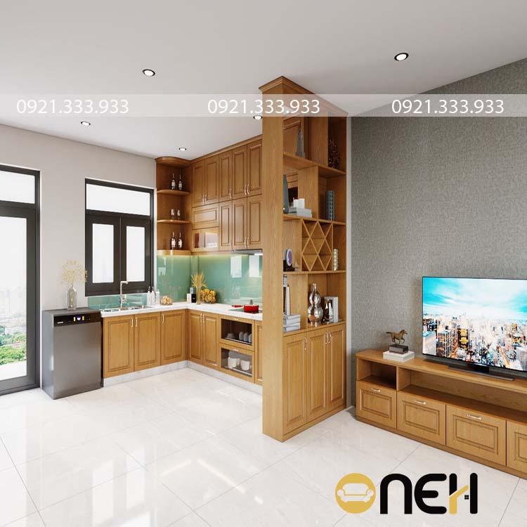Tủ bếp có màu gỗ vàng nổi bật, đặc biệt gia chủ kết hơp tủ bếp và kệ tủ lớn làm vách ngăn